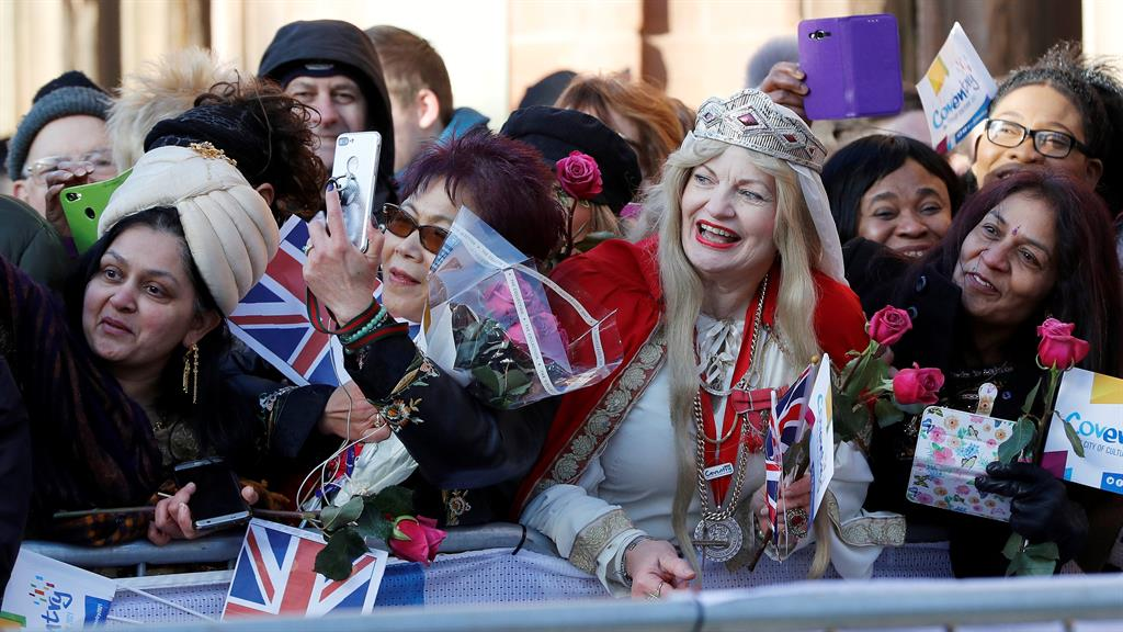 Warm welcome Well-wishers wait to greet William and Kate