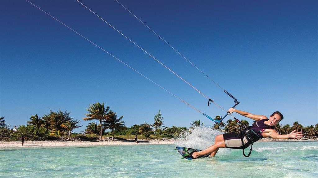Water lot of fun: Kitesurfing in Jardines del Rey and, inset, live music at Casa de la Trova