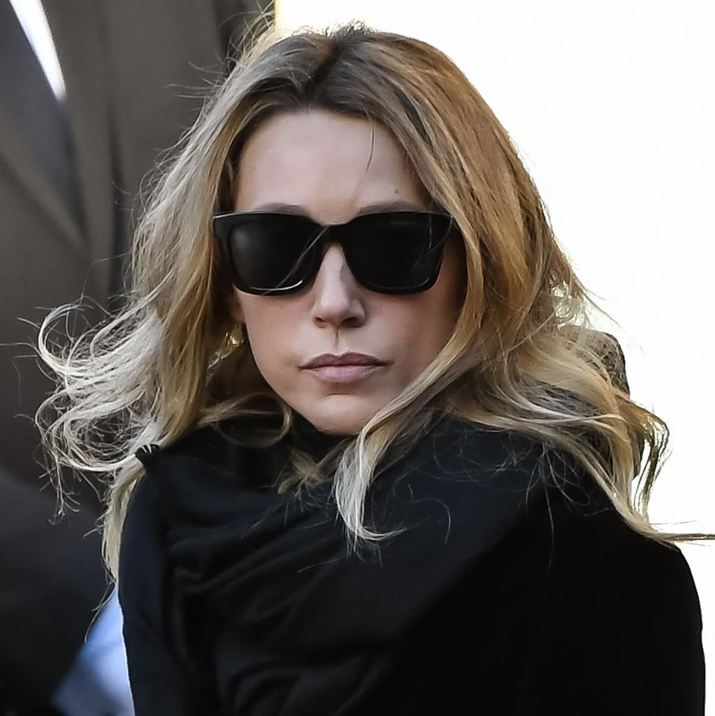 Pain: Laura Smet at Hallyday's funeral and (below) the star with fifth wife Laeticia, whom he left all his money to PICTURES: GETTY