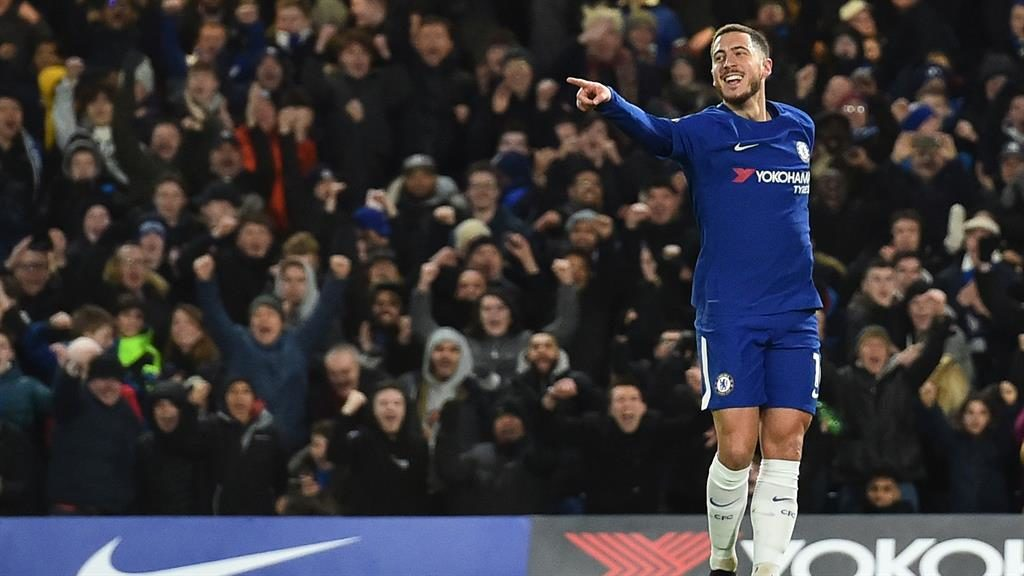 Ed boy: Hazard salutes his opener for the home side as Chelsea gave their manager Conte (below) something to celebrate at last