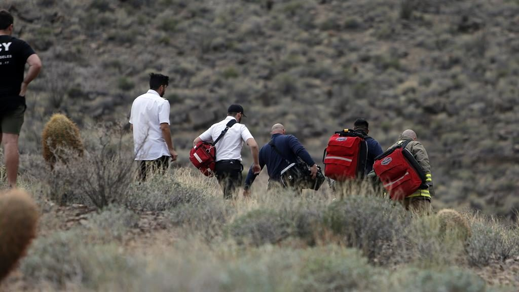 Remote site: Emergency crews make their way to the crash scene in the Grand Canyon PIC: AP