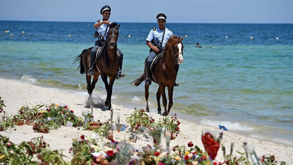 Terror: Police patrol Sousse beach after gunman Seifeddine Rezgui (below) massacred 38 people in 2015 PICTURES: GETTY/SKY