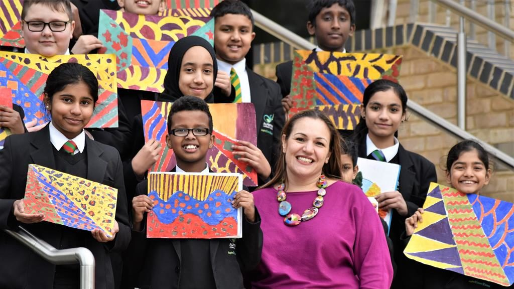 In a class of her own: Andria Zafirakou with some of her pupils at Alperton Community School