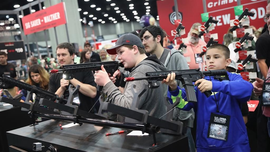 Bullets point: Gun lovers at an NRA meeting in Louisville, Kentucky PICTURE: GETTY