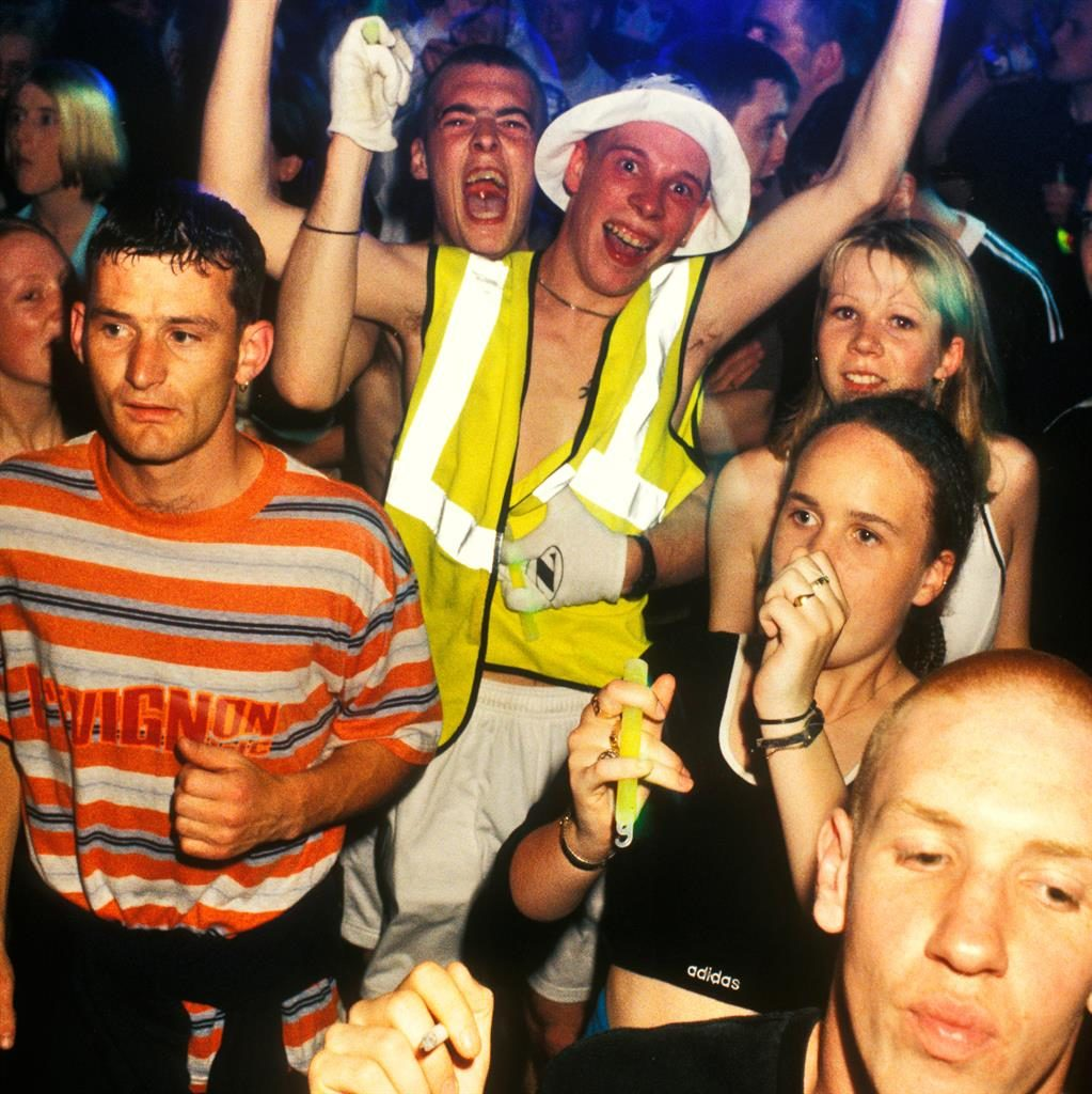 Party people: Acid house ravers in 1990 PIC: ALAMY