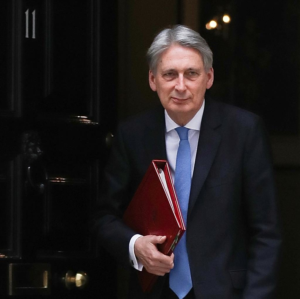 United Kingdom economy to grow slightly more quickly, Hammond predicts