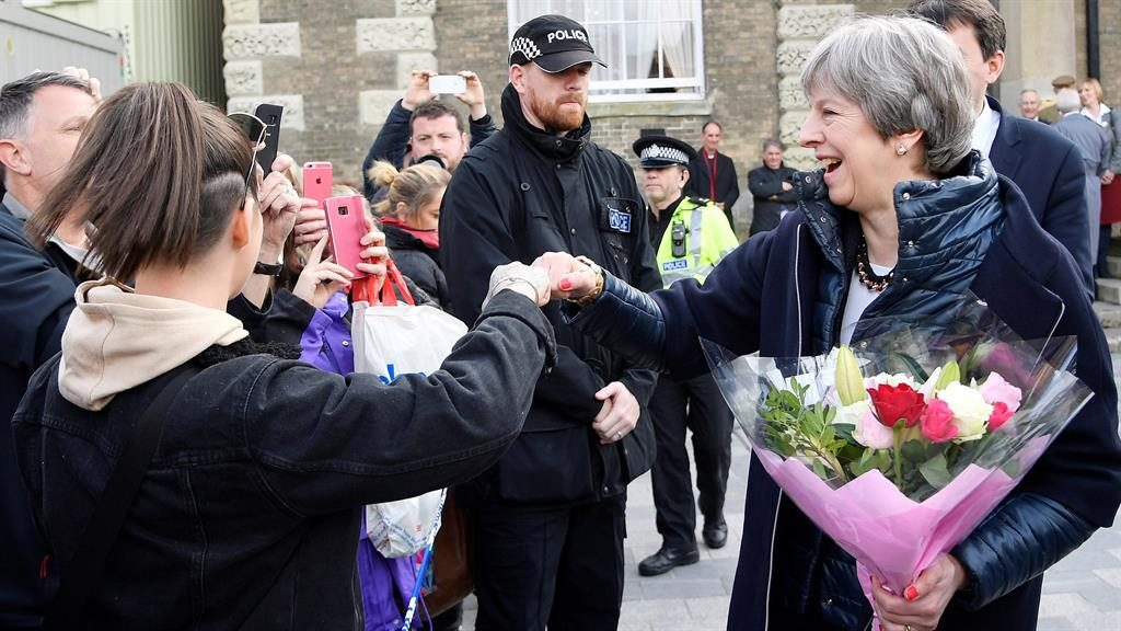 Bumps: A teenager greets the PM, who was given flowers by a well-wisher PIC: GETTY