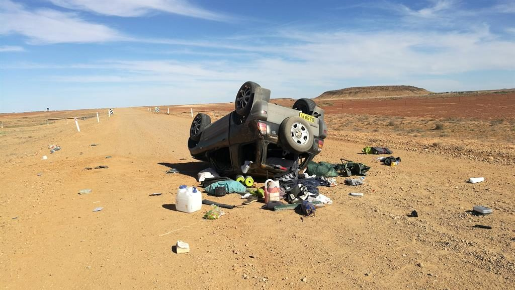It's a close call: Brad and Oliver's overturned SUV in the desert PIC: CATERS