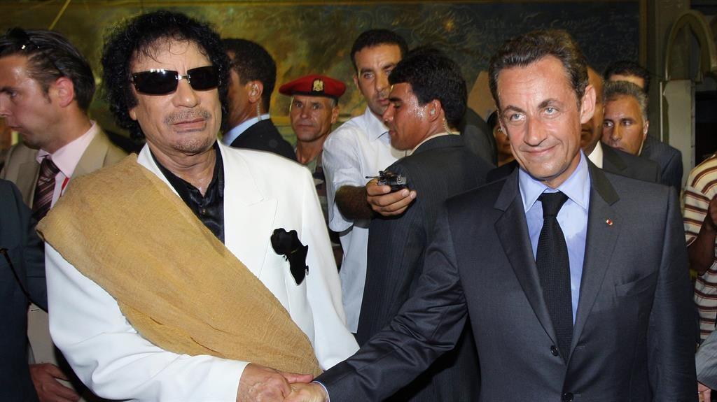 'Shake on it': Col Gaddafi greets Nicolas Sarkozy in Tripoli, Libya, in 2007 PIC: GETTY