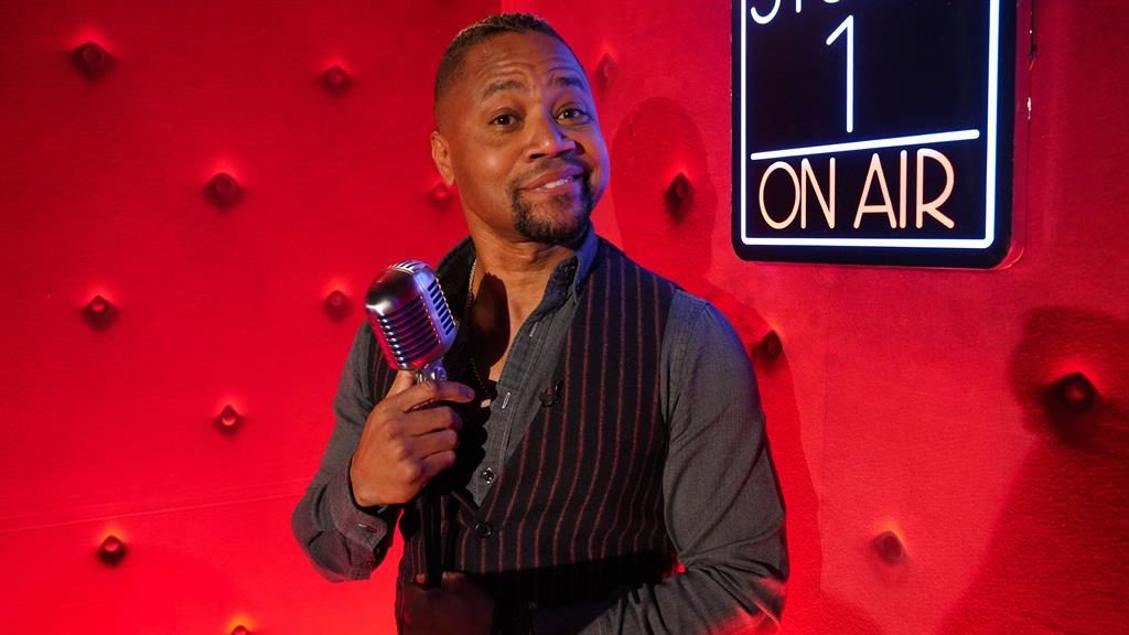 Magic mic: Cuba Gooding Jr will be testing out his vocal muscles as Billy Flynn in Chicago (below)  PICTURE: REX