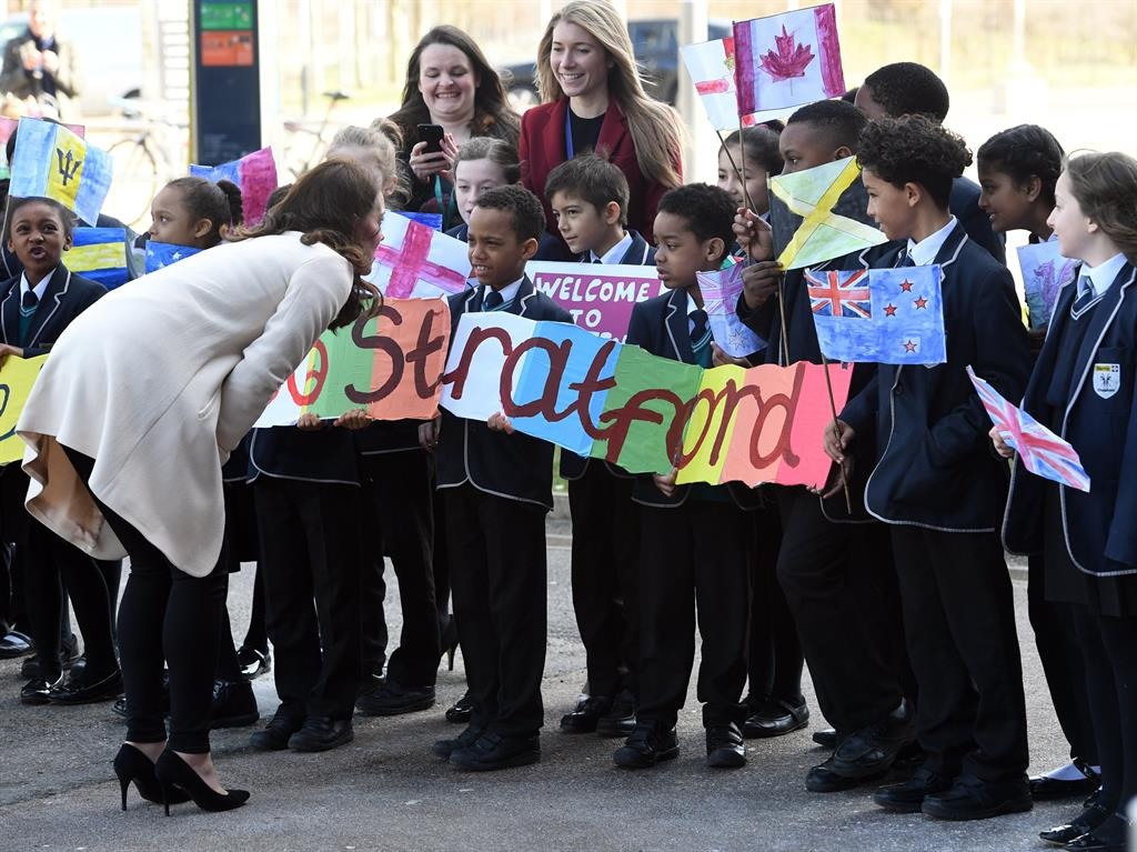 Last walkabout for a while Kate talks to children in the Olympic Park PIC EPA