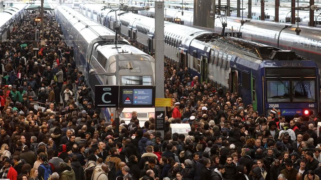 Crush hour: Commuters try to get home from Gare de Lyon in Paris last night PICTURES: AFP/AP