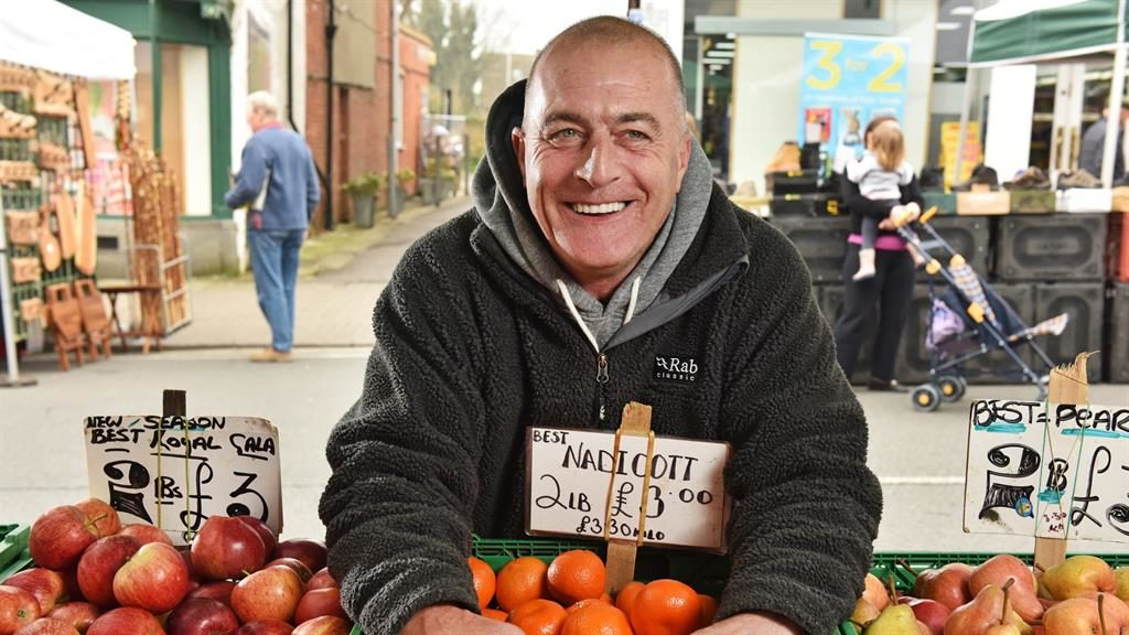 Stalled: Wayne Bellows at his fruit and vegetable stand at Lymington town market in the New Forest PICTURE: SOLENT NEWS