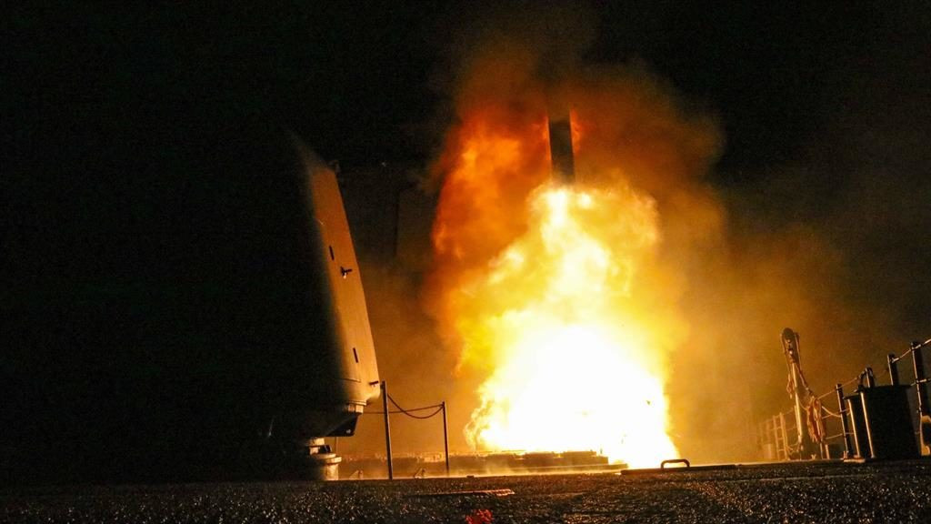 Lift-off: A missile is launched from the USS Monterey and (main pictures below) how one of the three facilities targeted was wiped out PICS: AP/GETTY