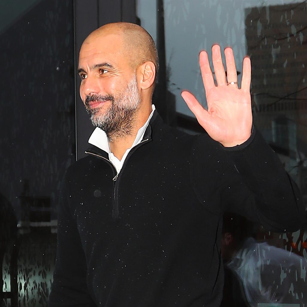 Guard of honour: City boss Guardiola arrives home last night after his team were confirmed as title winners, a moment the club celebrated by tweeting about 'our time, our city'