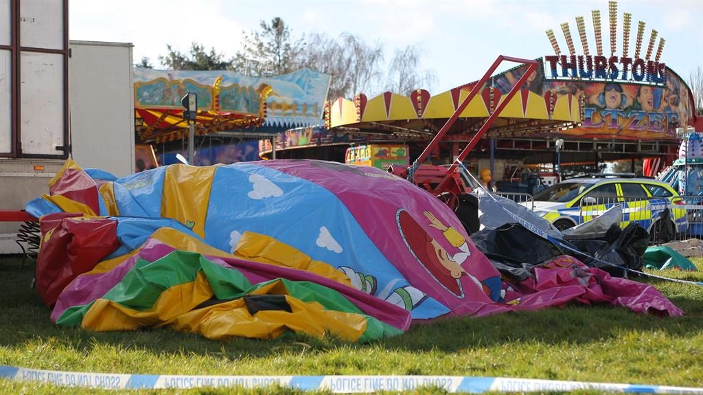 Tragedy: Police at the fairground where an inflatable carrying seven-year-old Summer 'flew into air' PIC: EASTNEWS PRESS