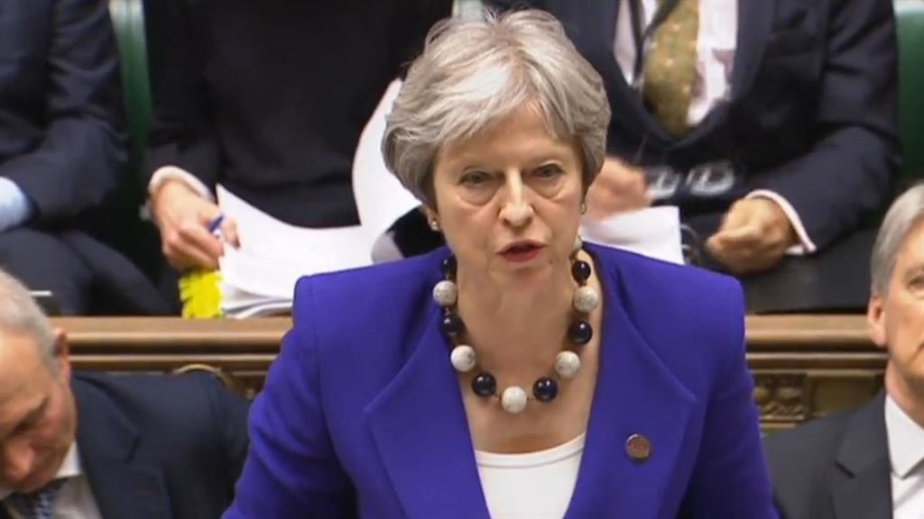 May apologizes for treatment of Caribbean migrants