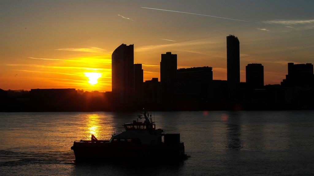 Sizzling sun: Dawn breaks in Liverpool yesterday