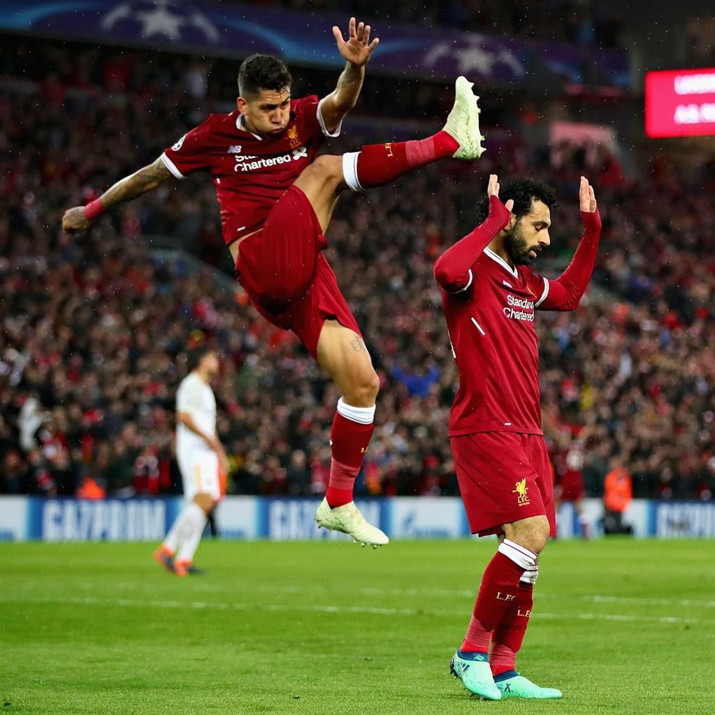 Flying high Firmino celebrates in style after Salah scores his second goal