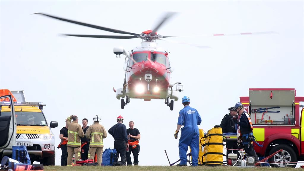 Emergency: Rescue services at the landmark where a body was later recovered PICTURE: EDDIE MITCHELL