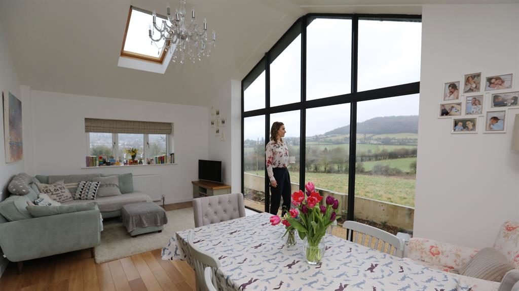 What a view: Amy Williams in front of the vast picture window in the extension, below