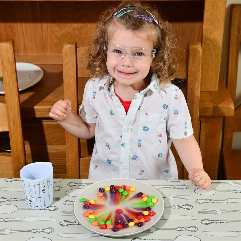 Hooked: Freya got keen on science experiments after dissolving Skittles to make a rainbow PICS: SWNS