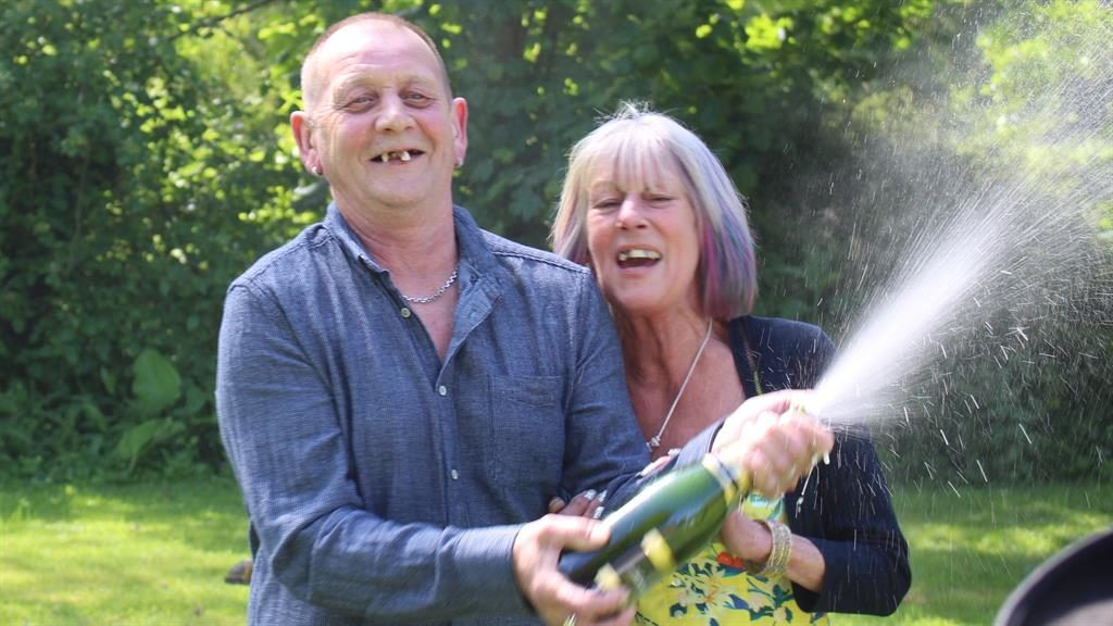 Champagne smiles: Matt and Marilyn crack open the bubbly to celebrate her £1million win PICS: EANS
