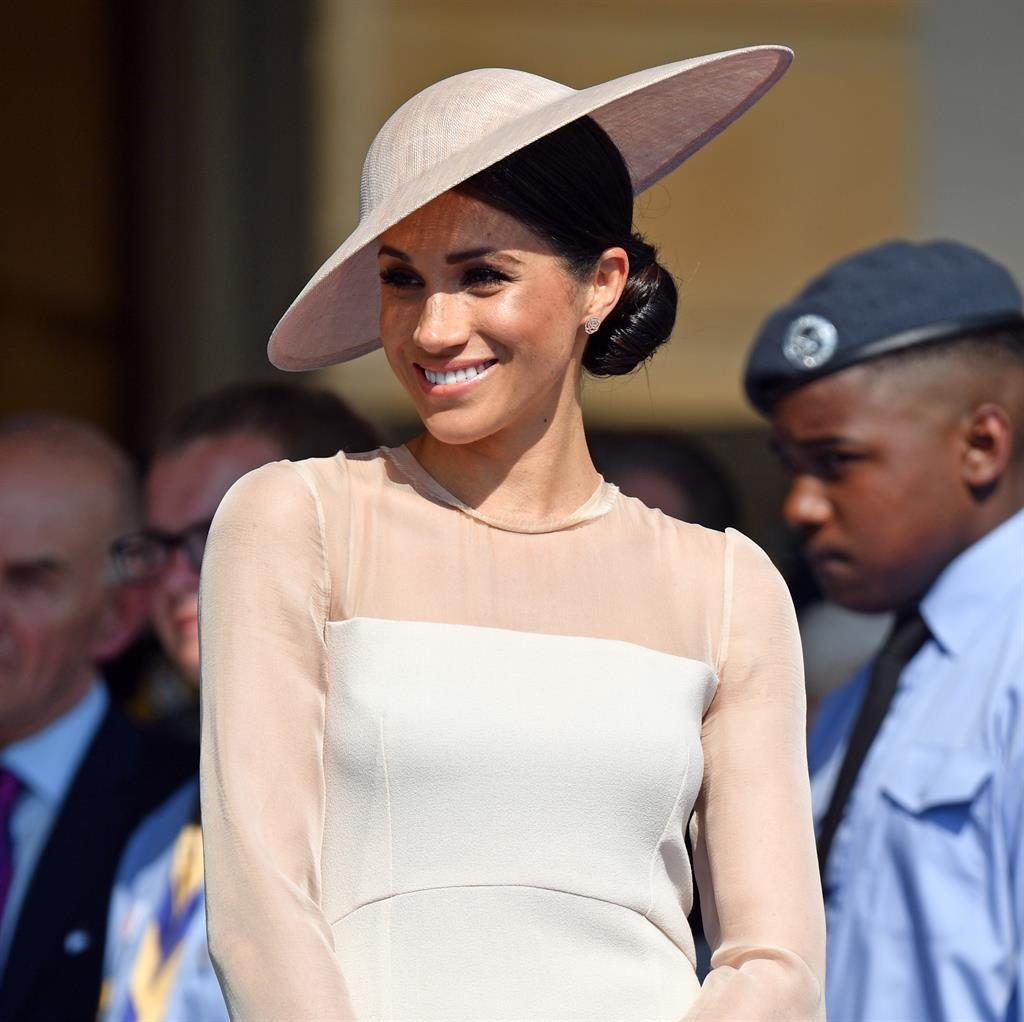 Royal blush: Meghan in blush-pink yesterday, on her first official outing since the wedding PICTURE: REX