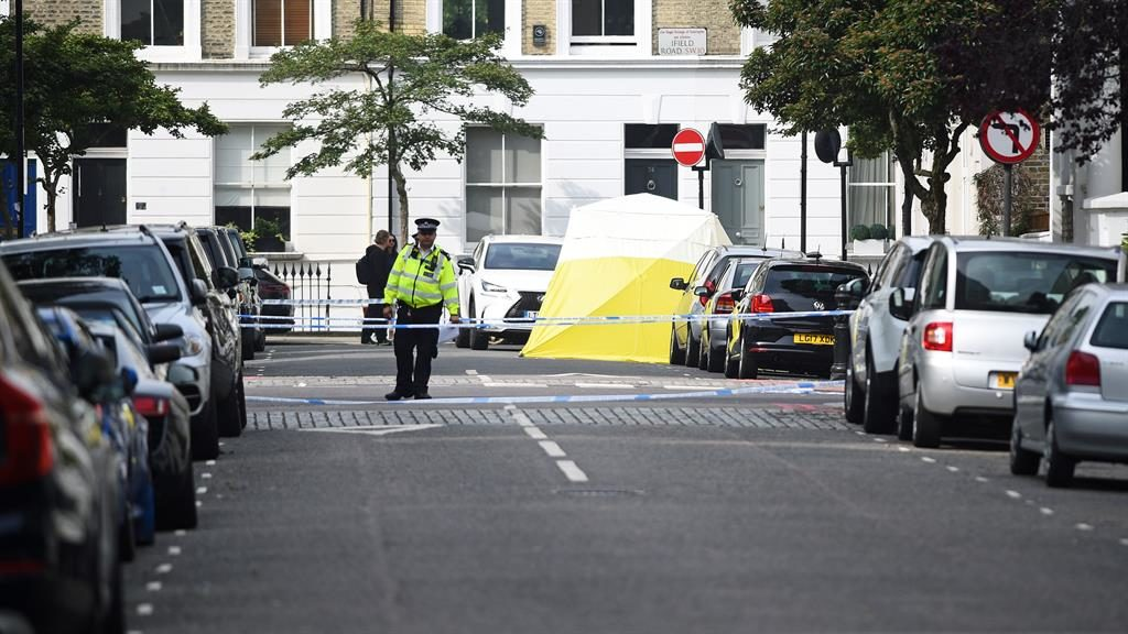 Murder: Police are investigating after a man, said to be a delivery driver, was killed in one of London's wealthiest areas PICTURES: PA/GETTY