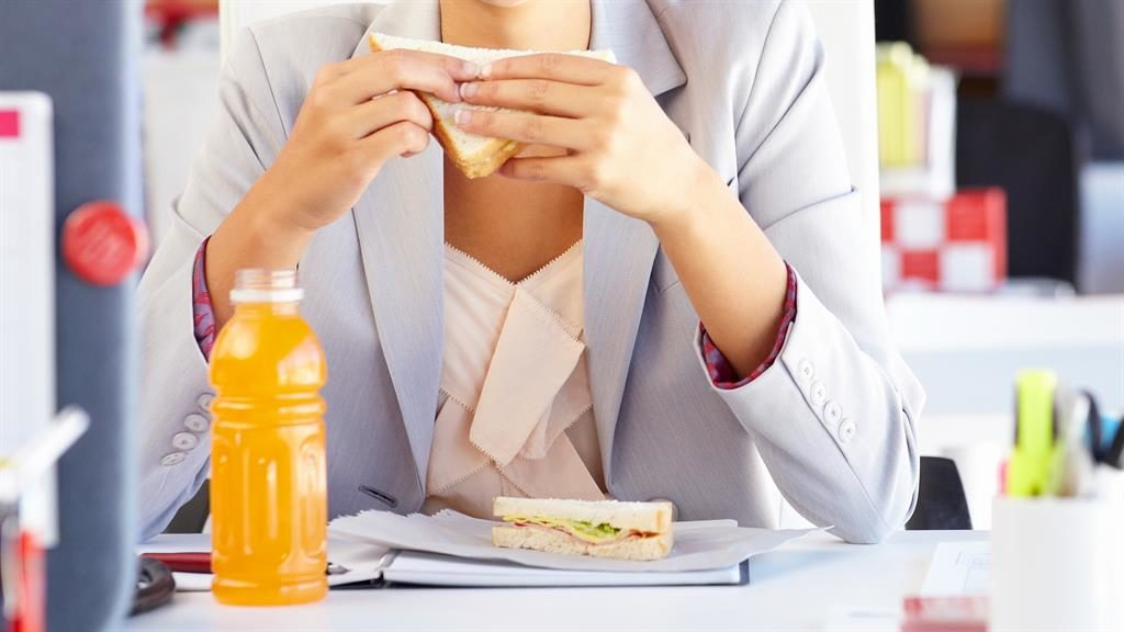 Why eating at work can add on the pounds