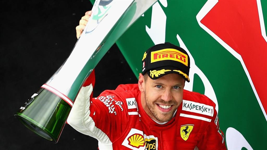 Winning weekend But Vettel's mood was dampened by critics