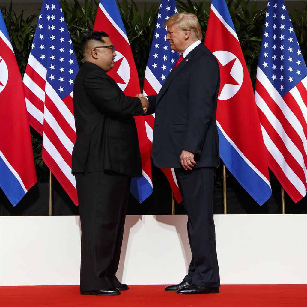 Face-to-face: Kim Jong-un and Donald Trump shake hands on Sentosa Island in Singapore PIC: AP