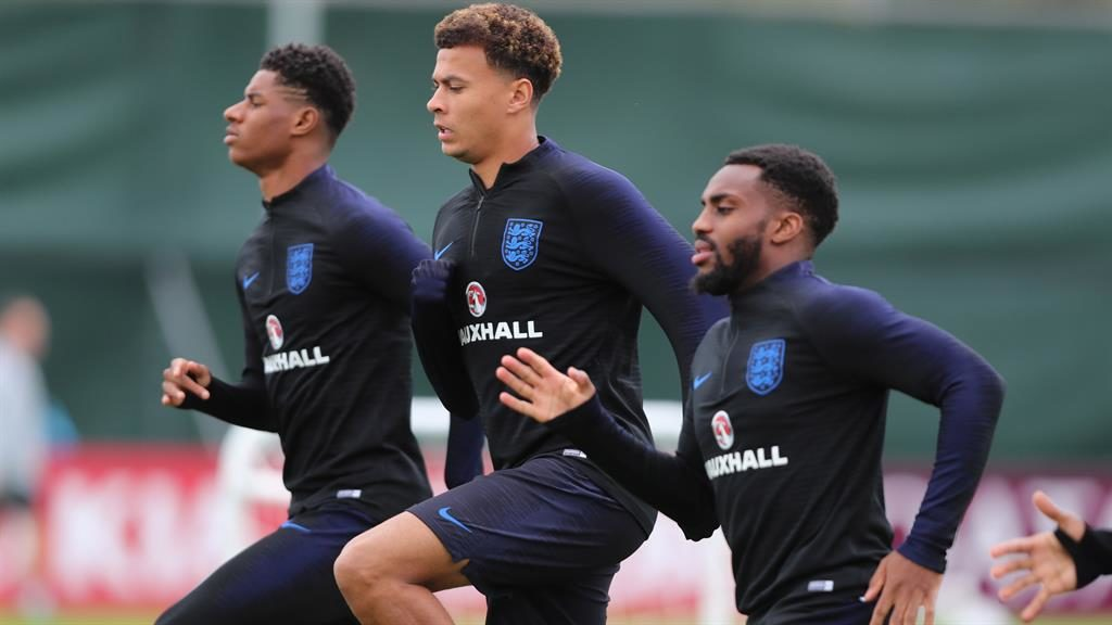Feeling his way back: Dele Alli (centre) with teammates Marcus Rashford (left) and Danny Rose PICTURE: GETTY