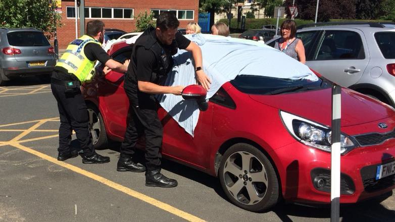 Smash and grab: Police cover the broken window on the Kia PICS: TRIANGLE