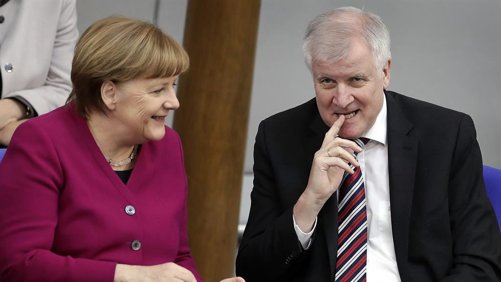 Angela Merkel reaches compromise to end immigration row threatening government