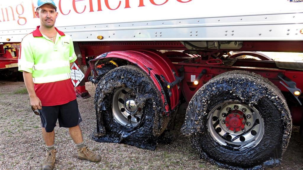 Keep on stickin': A lorry driver's wheels are covered with melted bitumen in Australia PIC: EPA