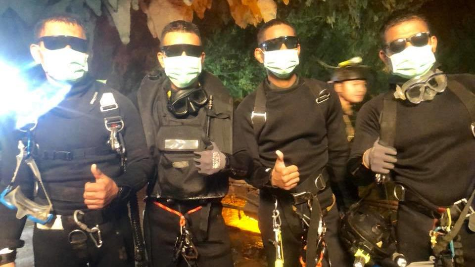 Thumbs up: A group of navy Seals who led the rescue effort signal success after last members of the boys' football team are brought to safety PICTURE: THAI NAVY SEALS