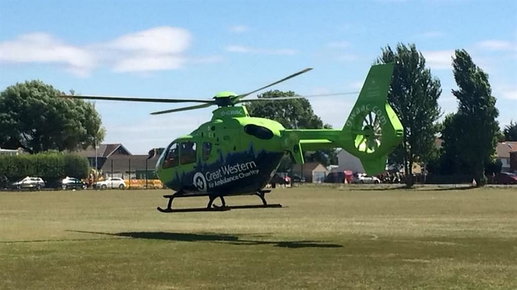 Emergency: An air ambulance at Baytree Recreation Ground rushes Mark Sperring to hospital PICTURE: SWNS