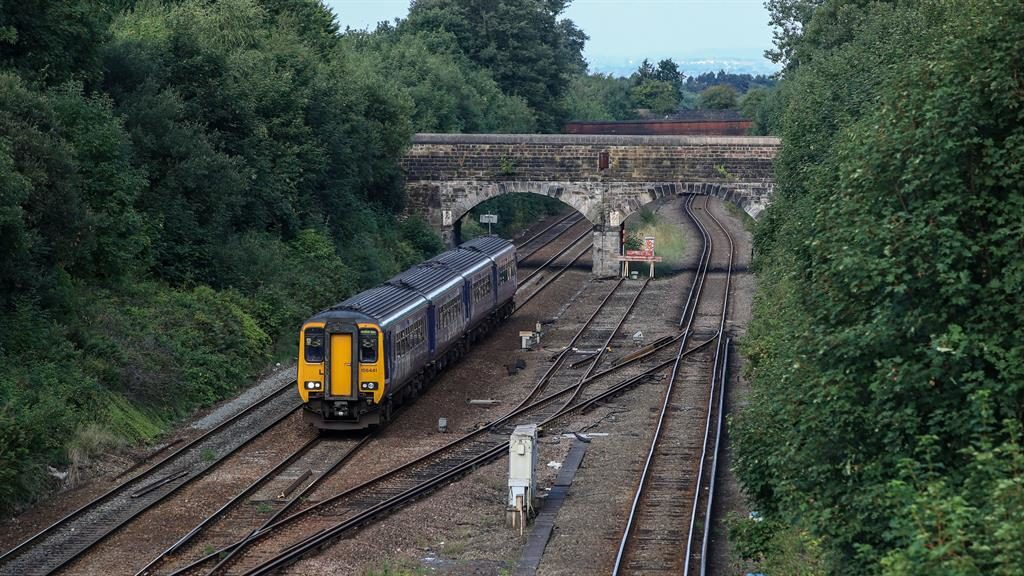 Delays: A Northern Rail train yesterday near Hunts Cross station, Liverpool PICTURE: PA