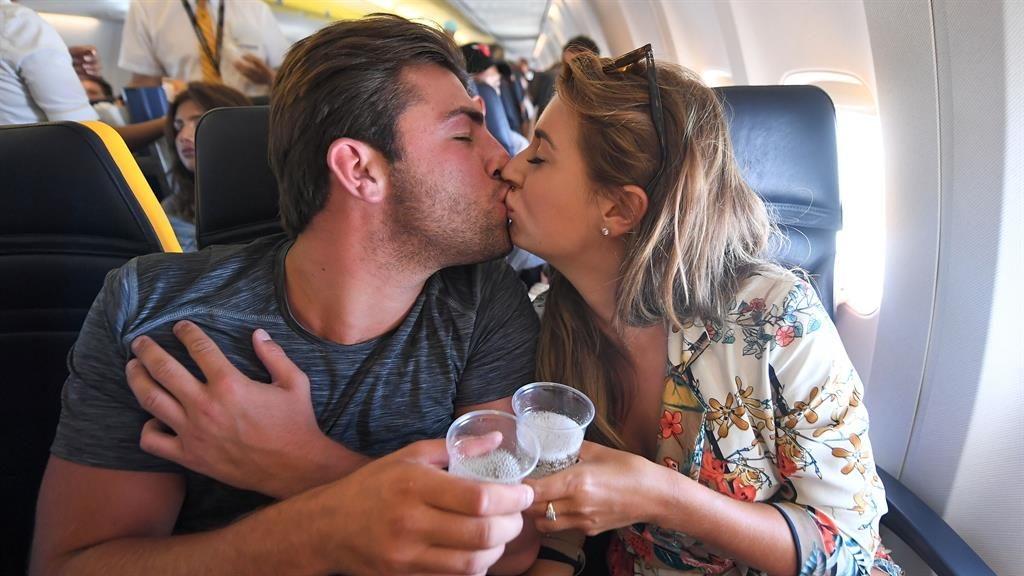 Snog over the. channel: Jack and Dani kiss on the plane. after weather. delayed their. departure. PICTURES: REX