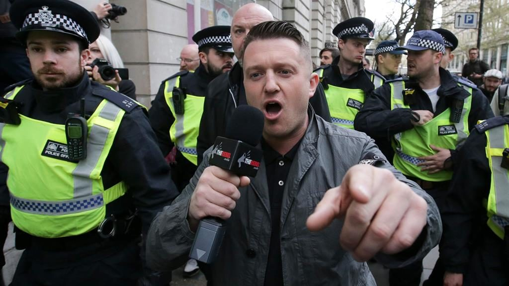 Out of jail: Robinson pictured last year being escorted away from a Britain First march