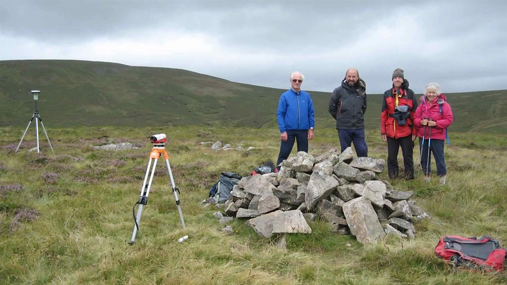 Hitting the heights: John Barnard and Jim Bloomer with John and Anne Nuttall near the summit of Miller Moss PICTURE: BNPS