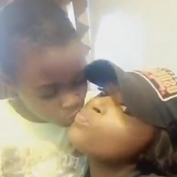 Emotional: Joel kisses sister Sarah in the clip she posted in tribute to the little boy, whose body was found in the burnt-out house (below) PICTURE: PA