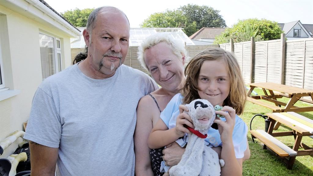 'We're in bits': Keith and Tania Caradeuc with their daughter Amber, 7 PICTURES: GUERSNEY PRESS/SWNS