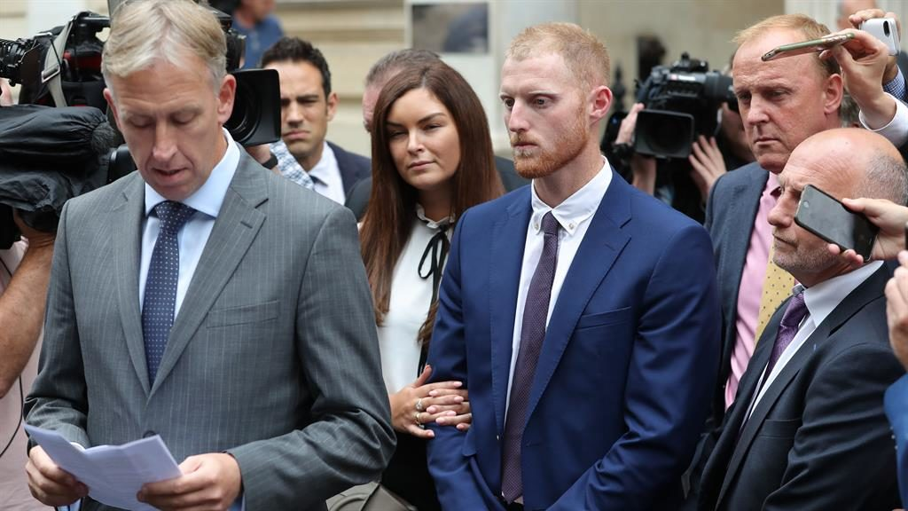 Free: Ben Stokes's lawyer Paul Lunt reads a statement outside Bristol Crown Court where the cricketer, centre, has been found not guilty of affray PICTURE: PA