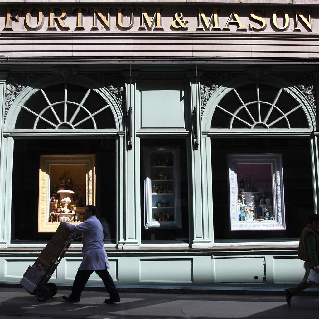 Top store: Fortnum & Mason where Mr Vallender and his son Jack (below) forgot to pay for eight bottles of champagne PICTURES: PA