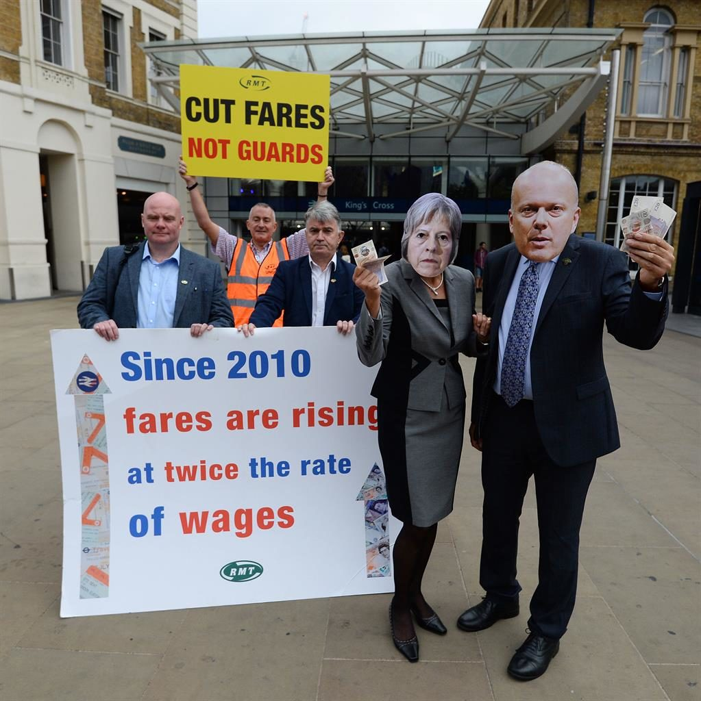 'Rip off': Mick Cash (centre) and RMT workers with protesters dressed as politicians PIC: PA
