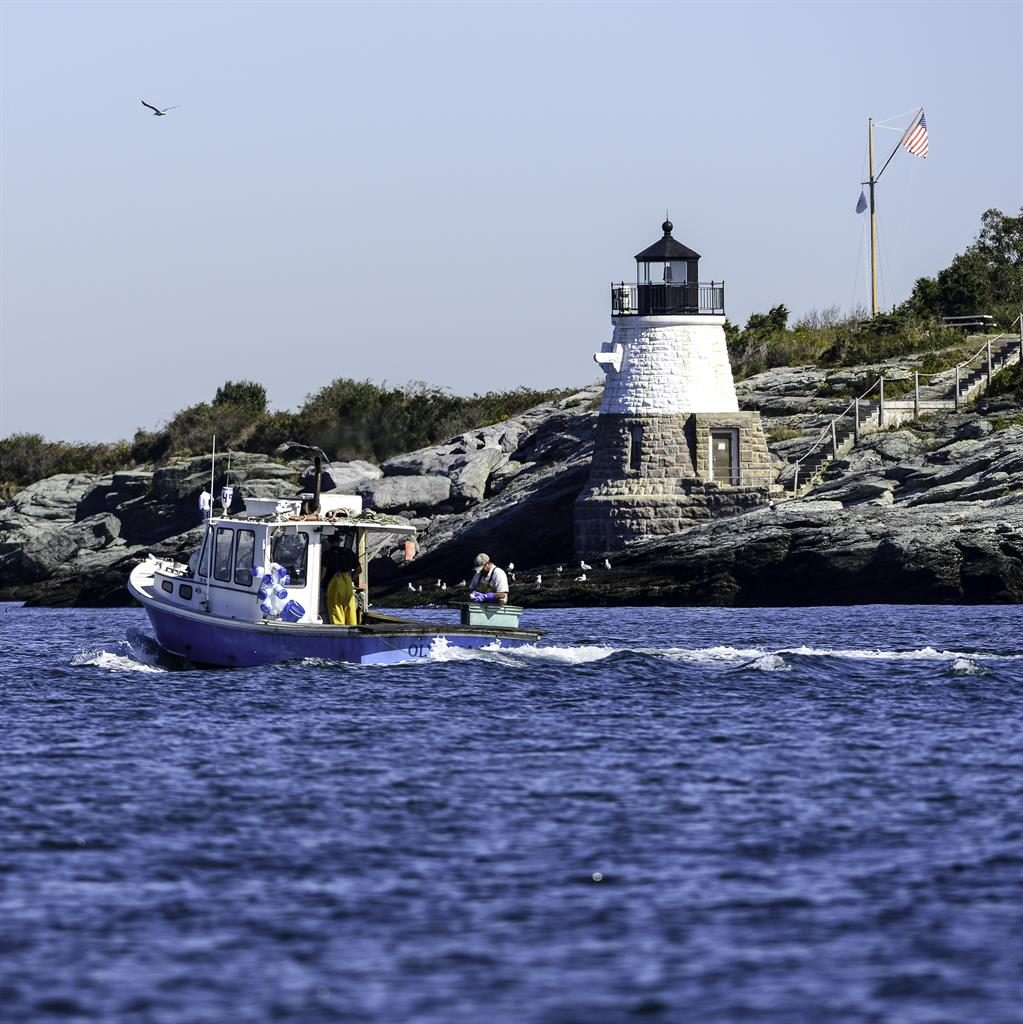 Welcome: Fishermen off the Rhode Island coast and, below, a busy wharf. Both feature in O'Halloran Schwarz's novel