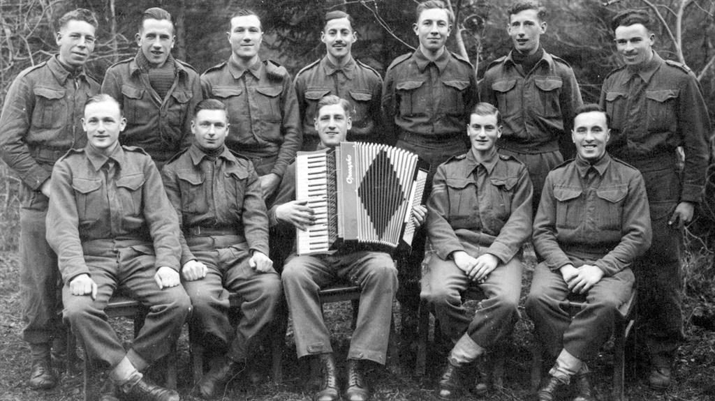 Brothers in arms: Cpl Jay (back row, centre) at a concert party while a PoW. (Below) his Stalag ID card