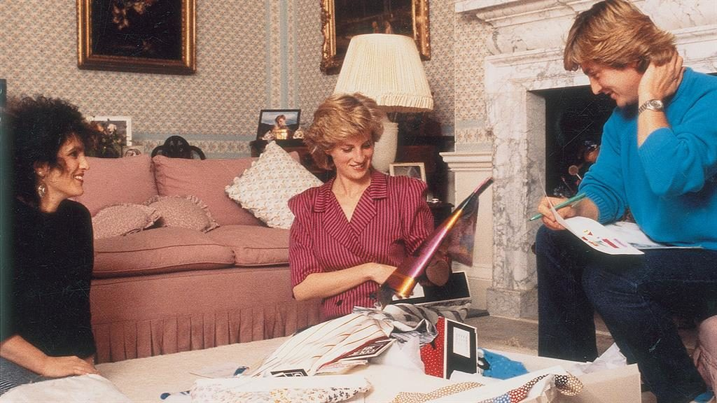 Custom made Princess looking through outfit designs with David and Elizabeth Emanuel for 1986 tour